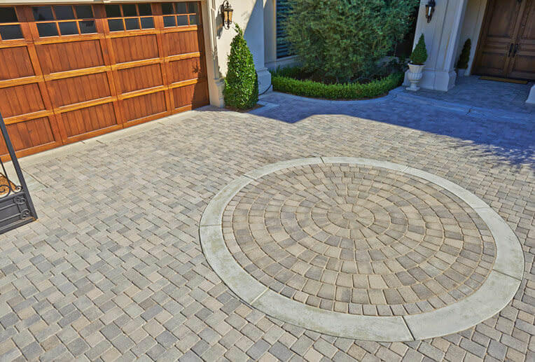 Gray Charcoal Antique Cobble I And II (tumbled) Installed In An U201cIu201d  Pattern. The Circle Is Gray Charcoal Antique Cobble Circle (tumbled).